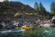 Rafters on Idaho's Middle Fork of the Salmon get help after pushing into the rocks.