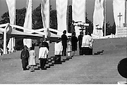 Pope John-Paul II visits Ireland..1979..29.09.1979..09.29.1979..29th September 1979..Today marked the historic arrival of Pope John-Paul II to Ireland. He is here on a three day visit to the country with a packed itinerary. He will celebrate mass today at a specially built altar in the Phoenix Park in Dublin. From Dublin he will travel to Drogheda by cavalcade. On the 30th he will host a youth rally in Galway and on the 1st Oct he will host a mass in Limerick prior to his departure from Shannon Airport to the U.S..Image of President and Mrs Hillery and an Taoiseach and Mrs Lynch ascending to the altar to receive Holy Communion.