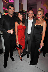 Left to right, STEVE JONES, TAMARA MELLON, GUY RITCHIE, and DIANA JENKINS  at the launch of Project PEP to benefit the Elton John Aids Foundation hosted by Tamara Mellon and Diana Jenkins in association with Jimmy Choo held at Selfridges, Oxford Street, London on 29th October 2009.