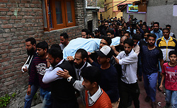 October 5, 2018 - Srinagar, Jammu and Kashmir, India - People carry the dead body of Nazir Ahmed Wani a Pro-India Political Worker during his funeral in Srinagar, Indian Administered Kashmir, 5 October 2018. Suspected rebels shot on three activists in which two of the workers succumbed  including Wani. (Credit Image: © Muzamil Mattoo/Pacific Press via ZUMA Wire)
