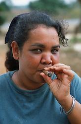 Portrait of woman on farm in Pinar Province; Cuba; smoking a cigar,