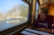 A young woman from England traveling on a morning train from Mostar to Sarajevo in Bosnia and Herzegovina