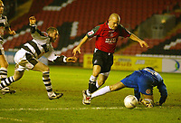 Photo: Aidan Ellis.<br /> Darlington v Swansea City. The FA Cup. 02/12/2006.<br /> Swansea's Andy Robinson goes past Darlington keeper Sam Russell to score the second goal