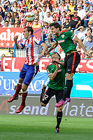 Atletico de Madrid´s Diego Godin and Athletic Club´s Unai Bustinza and Xabier Etxeita during 2014-15 La Liga match between Atletico de Madrid and Athletic Club at Vicente Calderon stadium in Madrid, Spain. May 02, 2015. (ALTERPHOTOS/Luis Fernandez)