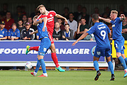 AFC Wimbledon striker Joe Pigott (39) getting fouled during the EFL Sky Bet League 1 match between AFC Wimbledon and Scunthorpe United at the Cherry Red Records Stadium, Kingston, England on 15 September 2018.