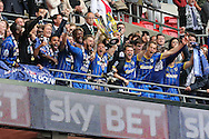 Barry Fuller, the AFC Wimbledon captain © celebrates with his team as he lifts the Sky Bet League 2 Play-off Trophy in the stands. Skybet football league two play off final match, AFC Wimbledon v Plymouth Argyle at Wembley Stadium in London on Monday 30th May 2016.<br /> pic by John Patrick Fletcher, Andrew Orchard sports photography.