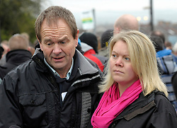 © Licensed to London News Pictures. 03/02/2013. Bristol, UK. Picture of Edwin Simons (left), father of Ross Simons, and Kelly Woodruff (right) sister of Ross Simons. More than 200 people attend a vigil at the scene where two cyclists, husband and wife Ross and Clare Simons, died after they were involved in a hit and run accident on 27 January with a vehicle in Lower Hanham Road, Hanham, Bristol.  The police have said they tried to flag the vehicle down before the accident because it was going at speed.  People at the vigil were asked to bring cans of Blackthorn cider and Fosters lager, the couple's favourites, and to write messages to the couple.  03 February 2013..Photo credit : Simon Chapman/LNP