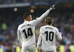 January 19, 2019 - Madrid, Madrid, Spain - Carlos H. Casemiro (Real Madrid) and Luka Modric (Real Madrid) are seen celebrating a goal during the La Liga football match between Real Madrid and Sevilla FC at the Estadio Santiago Bernabéu in Madrid. (Credit Image: © Manu Reino/SOPA Images via ZUMA Wire)