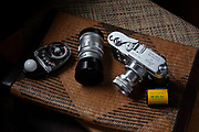 luxury-lifestyle-photos-by-photographer-randy-wells, Image of a Leica M3 35mm rangefinder film camera with 50mm and 90mm lenses, and a Sekonic light meter