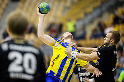 Povilas Babarskas of RK Celje PL vs Niko Medved of RK Gorenje during handball match between RK Celje Pivovarna Lasko and RK Gorenje Velenje in Eighth Final Round of Slovenian Cup 2015/16, on December 10, 2015 in Arena Zlatorog, Celje, Slovenia. Photo by Vid Ponikvar / Sportida