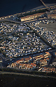 Ariel view over Saintes Maries de la Mer during the pelerinage des gitans. Caravan sites camping for gens de voyages, Roma,  Gitan and maounche at Saintes Maries de la Mer for the Gypsy festival<br /><br />Europe, France, Camargue, Saintes Maries de la Mer. The seaside town in the Camargue hosts a Gypsy festival once a year during May, where its landscape undergoes great changes. Otherwise it is a land bordered by sea, lakes and ponds, populated by flamengos, bulls and horses.
