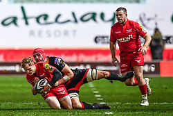Scarlets' Aled Davies is tackled by Dragons' Cory Hill<br /> <br /> Photographer Craig Thomas/Replay Images<br /> <br /> Guinness PRO14 Round 13 - Scarlets v Dragons - Friday 5th January 2018 - Parc Y Scarlets - Llanelli<br /> <br /> World Copyright © Replay Images . All rights reserved. info@replayimages.co.uk - http://replayimages.co.uk