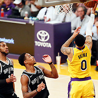 LOS ANGELES, CA - OCT 22: Los Angeles Lakers forward Kyle Kuzma (0) goes for the reverse layup during a game on October 22, 2018 at the Staples Center in Los Angeles, California.