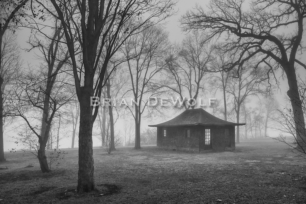 November fog envelopes the Japanese motif Boat House in Fabyan Forest Preserve, Geneva, Illinois. The Fox River is only a short distance behind the boat house.