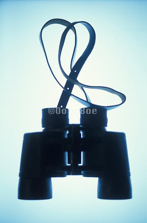 Binoculars on an illuminated background