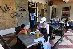 Jenny Escobar has breakfast with her children, Juliana and Jacob, at Vicky Cafe in Miramar that says will stay open till they run out of food Friday as Hurricane Irma head towards Florida. (Photo by Taimy Alvarez/Sun Sentinel/TNS/Sipa USA)<br />