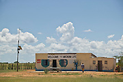 Africa, Namibia - A humorous and profound sign names a general store in the remote area near Ruacana in the far north at the Angolan border.  The store also hosts a simple radio telephone the only type of phone in this remote region.