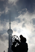 A man flies a kite on the Bund with the Pearl Oriental TV Tower in the background in Shanghai, China, on 19 October, 2010. Shanghai, China's largest city, is quickly becoming one of the major financial centers of the world.