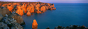 PORTUGAL, ALGARVE, SOUTH COAST Ponta da Piedade, rocky peninsula with a lighthouse, jutting into the sea just south of Lagos