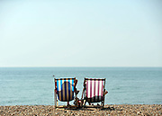 licensed to London News Pictures. BRIGHTON UK. 21/04/11.People flock to Brighton Beach today to catch the sunshine before the start of the Easter Bank Holiday in Britain. Temperatures are set to continue to rise over the weekend. Photo credit should read Stephen Simpson/LNP