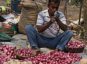 Onion seller, Assam, India.