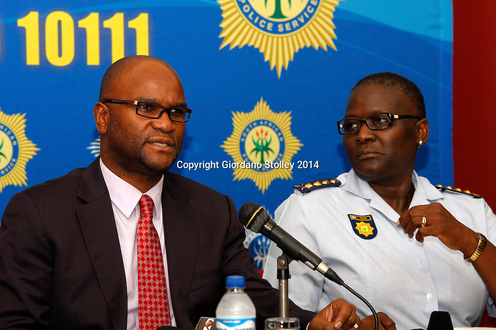DURBAN - 7 February 2014 - National police minister Nathi Mthethwa (lef) speaks at a press conference in Durban as National Police Commissioner Riah Phiyega looks on. They were attending a press conference at Durban's International Convention Centre where 1500 police station commanders attended a conference. Picture: Allied Picture Press/APP