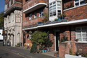 The Duke pub next to red brick apartment building in London, England, United Kingdom.