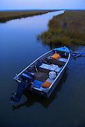 Fishing boat at dusk is docked at Turkey Point, a Delaware Bay Estuary in South Jersey.
