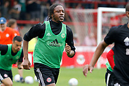 Brentford Midfielder Romaine Sawyers (19) warms up before kick off during the EFL Sky Bet Championship match between Brentford and Queens Park Rangers at Griffin Park, London, England on 21 April 2018. Picture by Andy Walter.