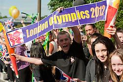 Olympic Torch reaches Sheffield Chapeltown/Ecclesfield/Parson Cross leg.<br /> School Children from Ecclesfield School celebrate the Olympic flame passing their school gates <br /> 25 June 2012.Image © Paul David Drabble