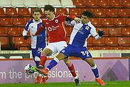 Blackburn Rovers midfielder Tyrhys Dolan (39) battles for possession with Barnsley defender Jordan Williams (2) during the EFL Sky Bet Championship match between Barnsley and Blackburn Rovers at Oakwell, Barnsley, England on 17 February 2021.
