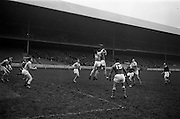 16/02/1964<br /> 02/16/1964<br /> 16 February 1964<br /> Railway Cup Football Semi Final: Munster v Ulster at Croke Park, Dublin. Munster full forward, M. Burke, gathers the ball in this jimp for possession with Ulster back G. Kelly (2).