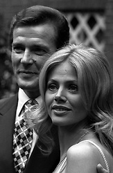 File photo dated 26/03/74 of Britt Ekland with Roger Moore, who has died in Switzerland after a short battle with cancer, his family has announced.