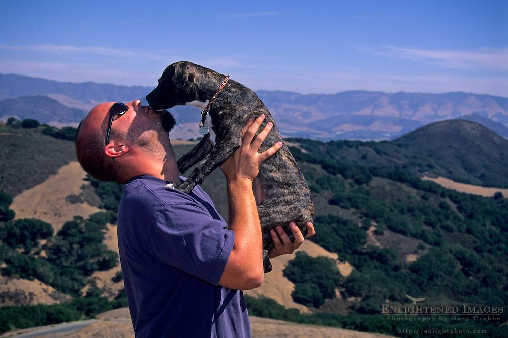 Getting some puppy love in the hills above San Luis Obispo, San Luis Obispo County, CALIFORNIA