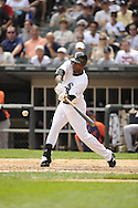CHICAGO - JULY 27:  Alejandro De Aza #30 of the Chicago White Sox bats against the Detroit Tigers on July 27, 2011 at U.S. Cellular Field in Chicago, Illinois.  The White Sox defeated the Tigers 2-1.  (Photo by Ron Vesely)  Subject: Alejandro De Aza