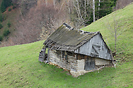 Old wooden house in village near Zarnesti, Transylvania, Romania