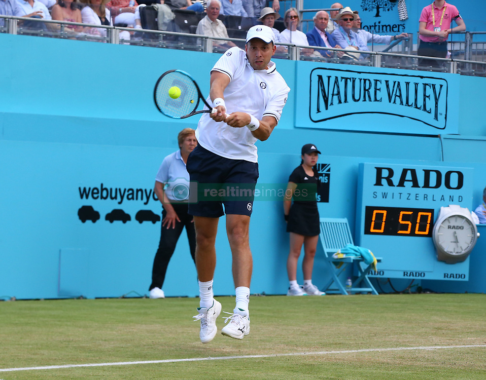 June 20, 2018 - London, England, United Kingdom - Gilles Muller (LUX) in action .during Fever-Tree Championships 2nd Round match between Frances Tiafoe (USA) against Leonardo Mayer(ARG) at The Queen's Club, London, on 20 June 2018  (Credit Image: © Kieran Galvin/NurPhoto via ZUMA Press)