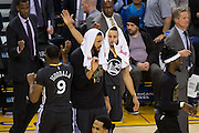 Golden State Warriors guard Stephen Curry (30) cheers for his teammates during a timeout against the Brooklyn Nets at Oracle Arena in Oakland, Calif., on February 25, 2017. (Stan Olszewski/Special to S.F. Examiner)