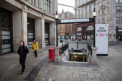 © Licensed to London News Pictures. 08/11/2020. London, UK. Members on the public walk past an entrance to the Underground in a quiet Oxford Circus in Central London. A national lockdown has been put in place in an attempt to fight a second wave of the COVID-19 strain of Coronavirus. Photo credit: George Cracknell Wright/LNP