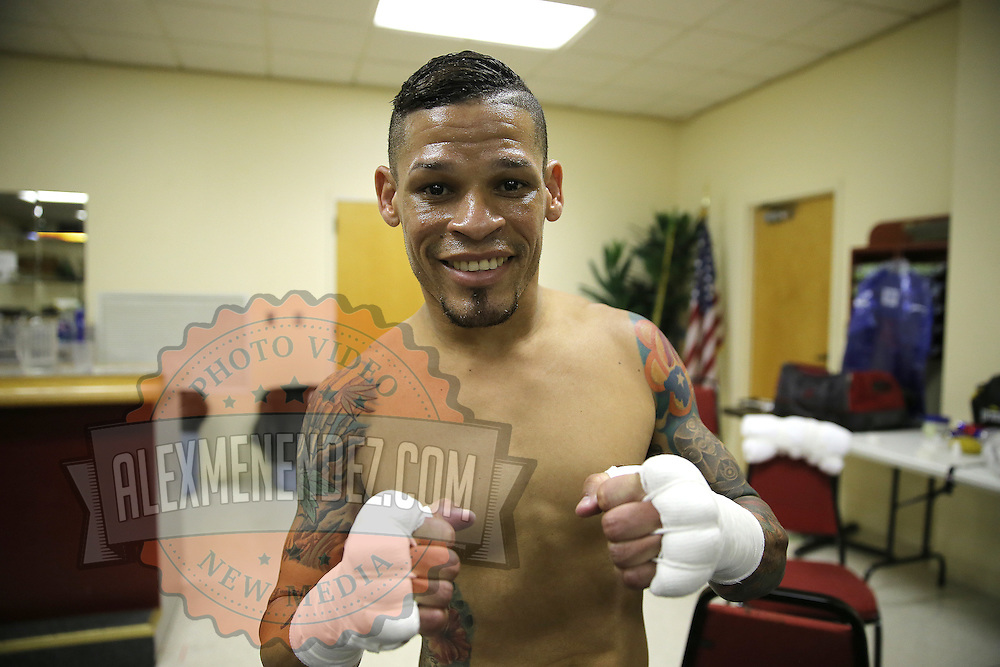 Professional boxer Orlando Cruz, the sports first openly gay fighter, poses prior to his match against Gamalier Rodriguez for the NABO Featherweight Title at the Bahia Shriners Center on Saturday, April 19, 2014 in Orlando, Florida.  (AP Photo/Alex Menendez)