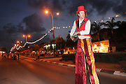 Clown on stilts at a festival. Photographed in Israel at Kfar Yona