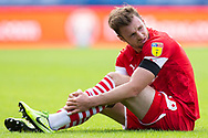 Barnsley defender Michael Sollbauer (18) on the ground in pain following a challenge during the EFL Sky Bet Championship match between Queens Park Rangers and Barnsley at the Kiyan Prince Foundation Stadium, London, England on 20 June 2020.