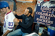 SHOT 12/10/17 12:58:21 PM - Former Buffalo Bills wide receiver and Hall of Fame player Andre Reed signs autographs and meets with fans at LoDo's Bar and Grill in Denver, Co. as the Buffalo Bills played the Indianapolis Colts that Sunday. Reed played wide receiver in the National Football League for 16 seasons, 15 with the Buffalo Bills and one with the Washington Redskins. (Photo by Marc Piscotty / © 2017)