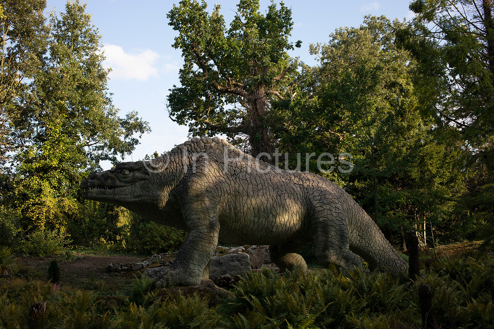 Dinosaur sculptures in Crystal Palace in London, United Kingdom. The Crystal Palace Dinosaurs are a series of sculptures of dinosaurs and other extinct animals, incorrect by modern standards, in the London borough of Bromleys Crystal Palace Park. Commissioned in 1852 to accompany the Crystal Palace after its move from the Great Exhibition in Hyde Park, they were unveiled in 1854 as the first dinosaur sculptures in the world. The models were designed and sculpted by Benjamin Waterhouse Hawkins representing the latest scientific knowledge at the time. The models, also known as Dinosaur Court, were classed as Grade II listed buildings from 1973, extensively restored in 2002, and upgraded to Grade I listed in 2007. The models represent 15 genera of extinct animals, not all dinosaurs. They are from a wide range of geological ages, and include true dinosaurs, ichthyosaurs, and plesiosaurs mainly from the Mesozoic era, and some mammals from the more recent Cenozoic era. Today, the models are notable for representing the scientific inaccuracies of early paleontology.