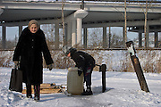 Khabarovsk, Russia, 01/03/2004.&#xD;Collecting drinking water from a well in an old part of the city near the centre.&#xD;<br />