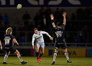 Saracens full-back Alex Goode chips over the Sale defence during the Aviva Premiership match Sale Sharks -V- Saracens at The AJ Bell Stadium, Salford, Greater Manchester, England on Friday, February 16, 2018. (Steve Flynn/Image of Sport)