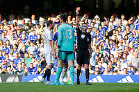 Chelsea's Thibaut Courtois is shown a red card by referee Michael Oliver<br /> <br /> Photographer Craig Mercer/CameraSport<br /> <br /> Football - Barclays Premiership - Chelsea v Swansea City - Saturday 8th August 2015 - Stamford Bridge - London<br /> <br /> © CameraSport - 43 Linden Ave. Countesthorpe. Leicester. England. LE8 5PG - Tel: +44 (0) 116 277 4147 - admin@camerasport.com - www.camerasport.com