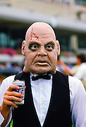 Racegoer  wearing a  face mask to  the Melbourne Cup Race Day, Australia