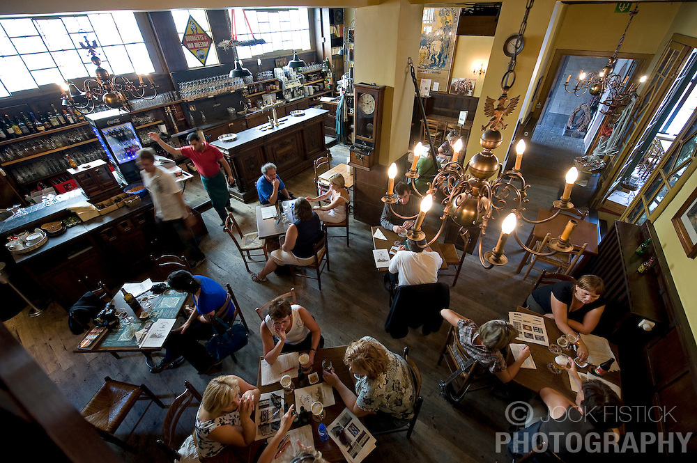 Patrons enjoy food and drink at Het Anker, a restaurant that is part of the family owned Gouden Carolus Brewery, in Mechelen, Belgium on Thursday, Sept. 11,2008. The brewery has been in business since the 14th century. (Photo © Jock Fistick)