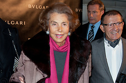 File photo - Liliane Bettencourt and Alain Thurin attending the Exhibition Launch for Bvlgari 125th Anniversary Celebration (125 years of italian splendour) held at the Grand Palais on December 9, 2010 in Paris, France. Liliane Bettencourt has died aged 94 it was announced on September 21, 2017. Bettencourt was the richest person in France and the third-richest woman in the world with a net worth of $40 billion. She was the sole heir to L'Oreal, the largest cosmetics company in the world, which was started by her father, and a large shareholder in Nestle. Nearly a decade ago a trial forced Liliane's personal business into the public light, laid bare her obsession with a flashy homosexual photographer whom she turned into a billionaire, destroyed her relationship with her daughter, turned a long time family butler against her, and, finally, turned the dowager heiress into even more of a recluse than she had been before. Photo by Nicolas Genin/ABACAPRESS.COM